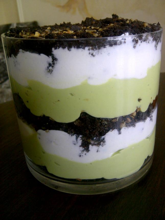 Layers of chocolate cake, avocado cream and whipped cream